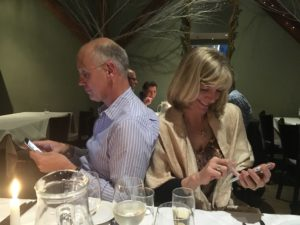 Texting at dinner .. how wude!