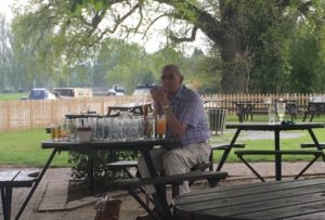Chap with a drinking problem on the adjacent table